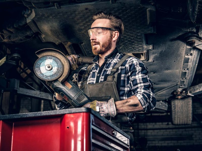 mechanic-in-protective-googles-holds-angle-grinder-small-1.jpg